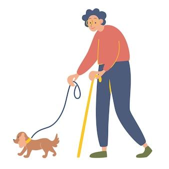 Oudere vrouw met een wandelstok op een wandeling met haar geliefde hond gelukkige oude dame met haar favoriete huisdier