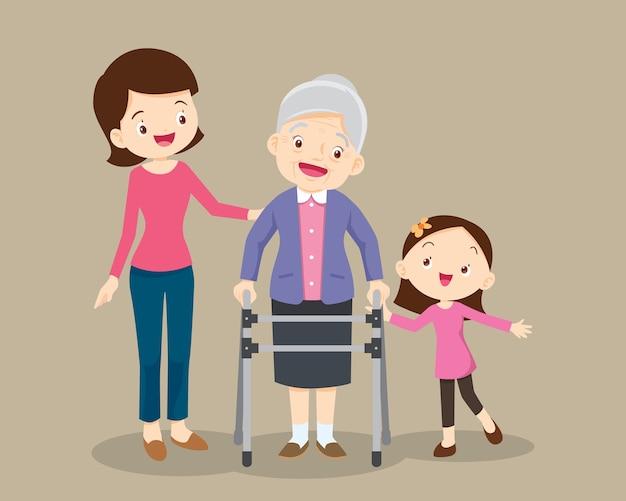 Ouderen lopen. kleindochter en moeder helpen grootmoeder om naar de rollator te gaan.
