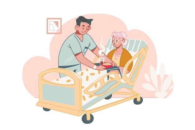 Ouderenzorg . maatschappelijk werker of vrijwilliger zorgt voor en helpt een bedlegerige oudere vrouw met een handicap in een verpleeghuis.