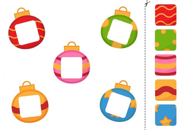 Overeenkomen met delen van leuke cartoon kerstballen. knip en lijm spel voor kinderen.
