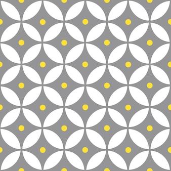 Overlappende cirkels en polka dot abstract. geel en grijs geometrisch naadloos patroon.