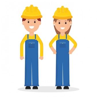 Paar bouwers werknemers met helmen