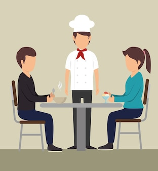 Paar dat bij een lijst naast chef-kok eet