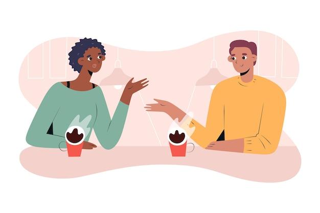 Paar drinikg koffie en praten datum in café