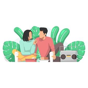 Paar genieten van picknick op de natuur