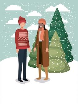 Paar in snowscape met winterkleren