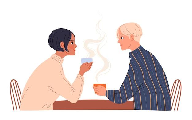 Paar jonge mensen zitten in een café met koffie.