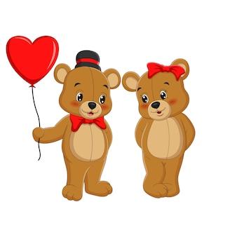 Paar leuke teddyberen die huidige liefdeballons geven