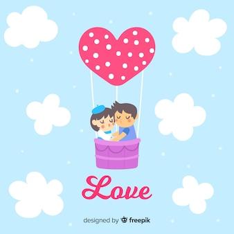Paar op de valentijnskaartachtergrond van de hete luchtballon
