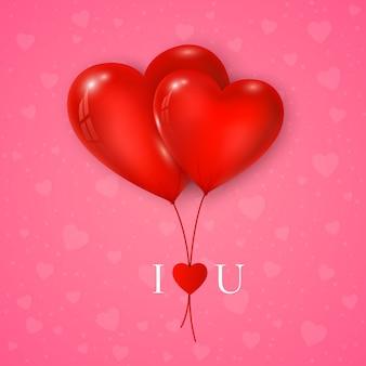 Paar rode harten ballon met bericht i love you. valentijnsdag wenskaart op roze achtergrond.