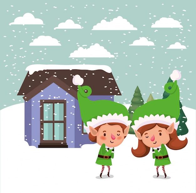 Paar santahelpers in snowscape