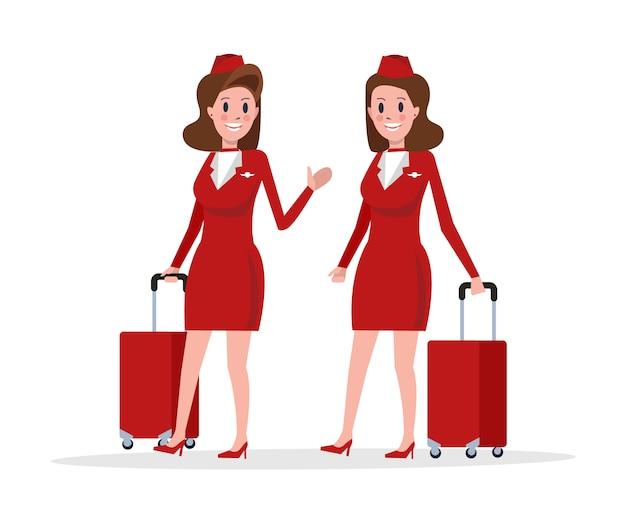 Paar stewardess in rode uniforme wandelen