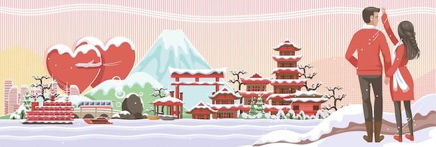 Paar wittebroodsweken op de japanse achtergrond van de de winterbanner