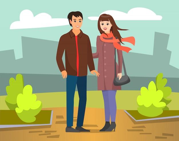 Paarman en vrouw die in autumn city park lopen