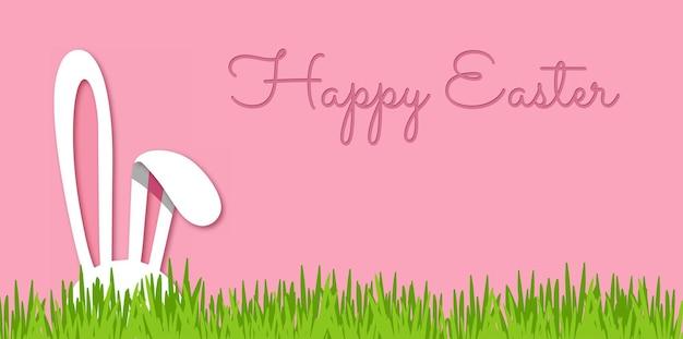 Paasbanner met konijnenoren en groen gras schattige roze achtergrond met konijnpapier gesneden stijl
