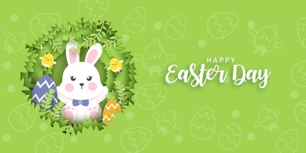 Paasdagkaart met schattige konijnen en paaseieren.