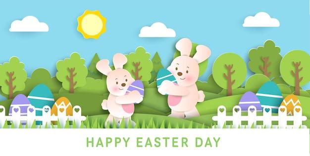 Paasdagkaart met schattige konijnen en paaseieren