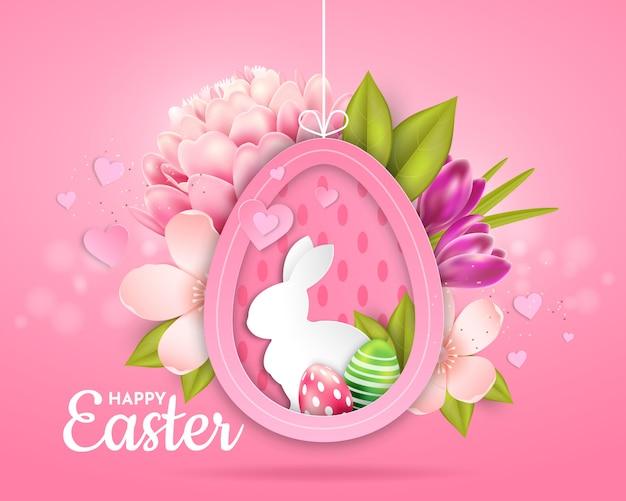 Paaskaart met de afbeelding van een konijn, eieren en bloemen