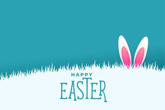 Paaskaart met konijntjeskonijn die achter gras plassen