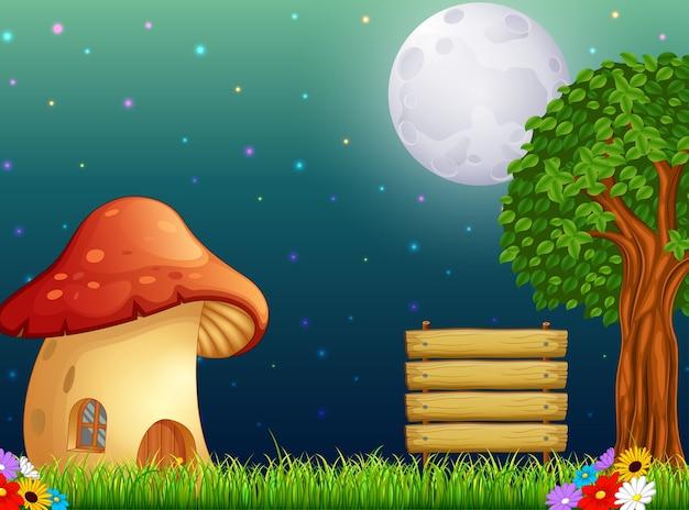 Paddestoelhuis en de heldere maan op bos