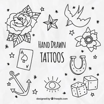 Pak van decoratieve hand getekende tatoeages
