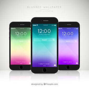 Pakje van drie mobiele telefoons met elegante gekleurde wallpapers