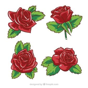 Pakje van vier met de hand getekende rode rozen Gratis Vector