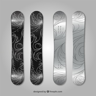 Pakje van vier snowboards met abstracte ontwerpen