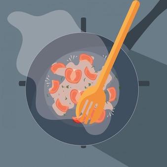 Pan van keuken met houten vork en gebraden tomaten