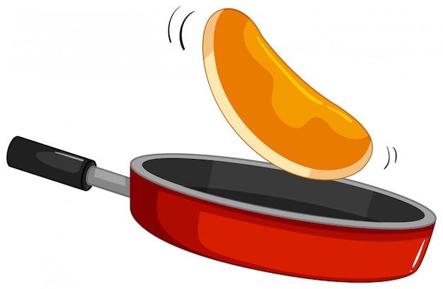 Pannenkoek flipt op de pan