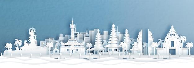 Panoramamening van de skyline van denpasar, bali, indonesië met wereldberoemde bezienswaardigheden van indonesië in papier gesneden stijl illustratie.