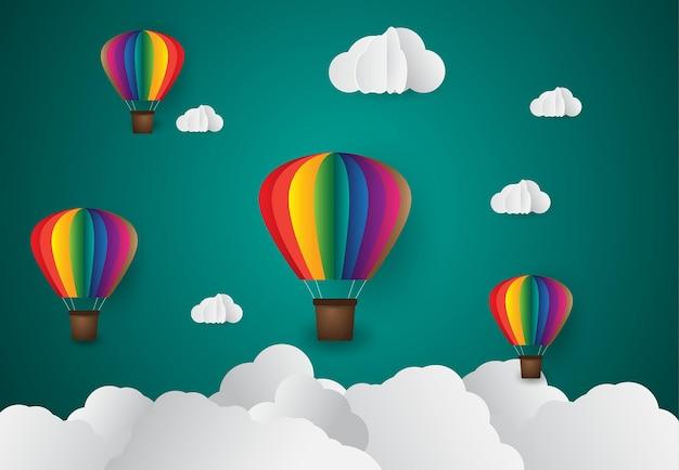 Papier kunststijl origami maakte kleurrijke luchtballon wolk blauwe lucht en zonsondergang