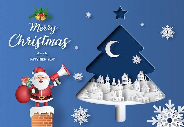 Papier kunststijl van de kerstman met een zak vol geschenken met megafoon