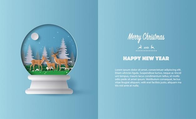 Papier kunststijl van een hert familie in christmas globe wenskaart