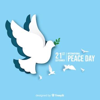 Papier vrede dag achtergrond met duif