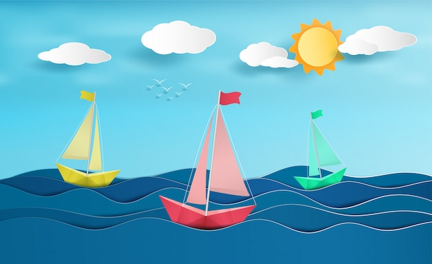 Papier zeilboot zeilen op de oceaan.