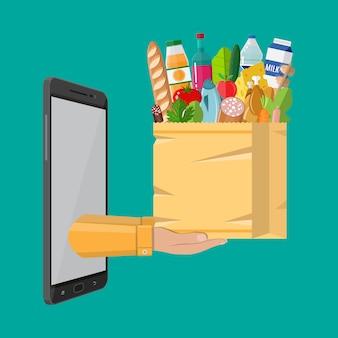 Papieren boodschappentas vol boodschappen producten