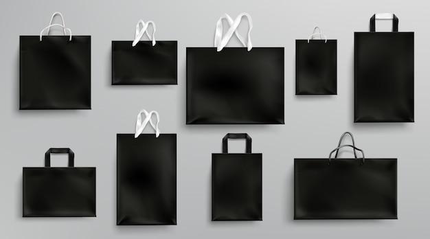 Papieren boodschappentassen mockup, zwarte pakketten ingesteld
