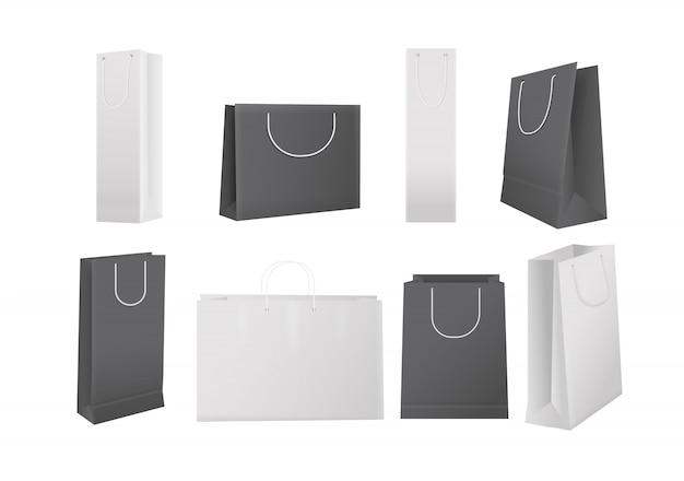 Papieren boodschappentassen. realistische witte en zwarte kartonnen boodschappentassen geïsoleerde set