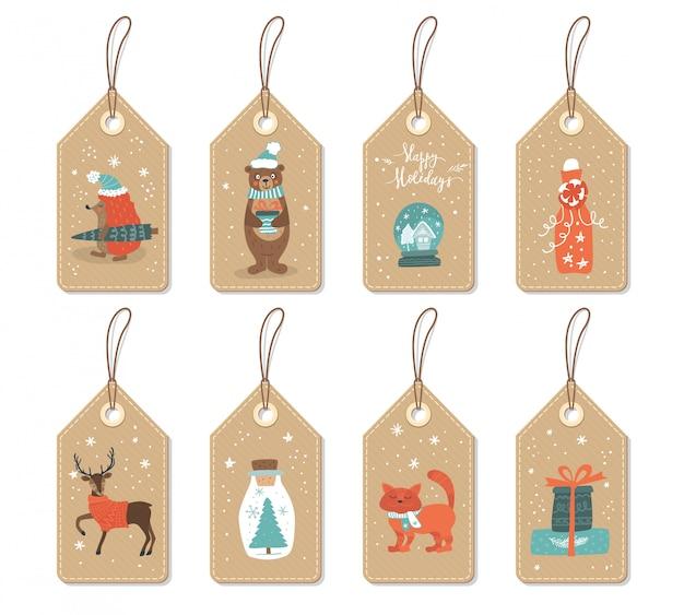 Papieren tags met schattige kerstdieren en elementen