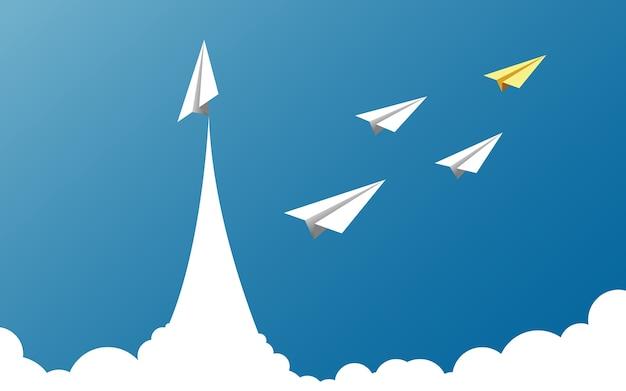 Papieren vliegtuig als een leider onder een ander vliegtuig