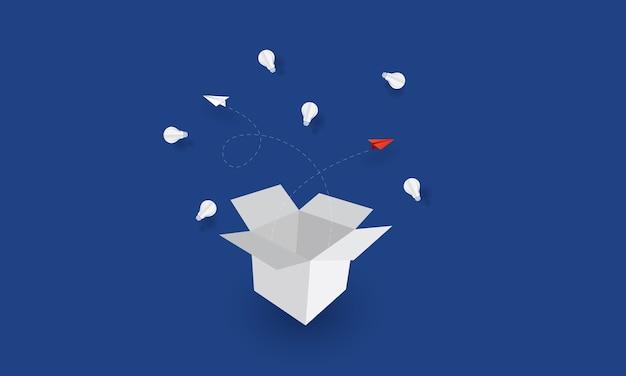 Papieren vliegtuig vliegt uit de doos, denk uit de doos, bedrijfsconcept