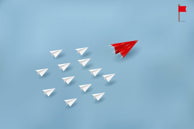 Papieren vliegtuigen concurreren met bestemmingen. zakelijke financiële concepten