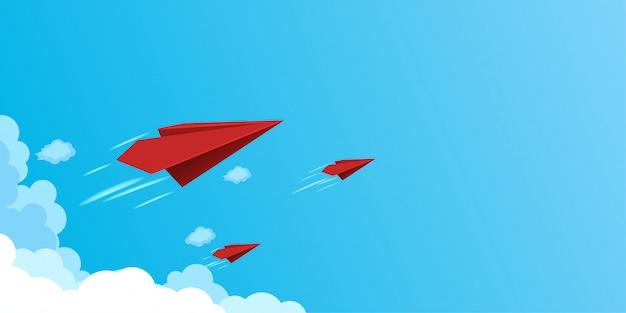 Papieren vliegtuigen vliegen op blauwe hemel. business teamwork en leiderschap concept.
