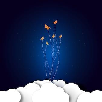 Papieren vliegtuigen vliegen op donkerblauw