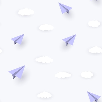 Papieren vliegtuigje en wolken naadloze patroon achtergrond