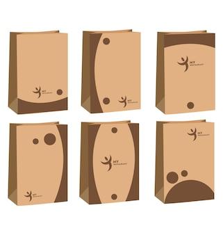 Papieren zak met 6 minimalistische ontwerpen in bruin vooraanzicht set papieren zakken