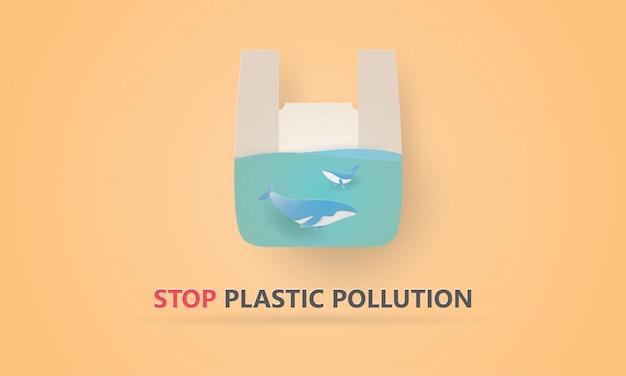 Papierkunst van blauwe vinvis in een plastic zak, wereldmilieudag