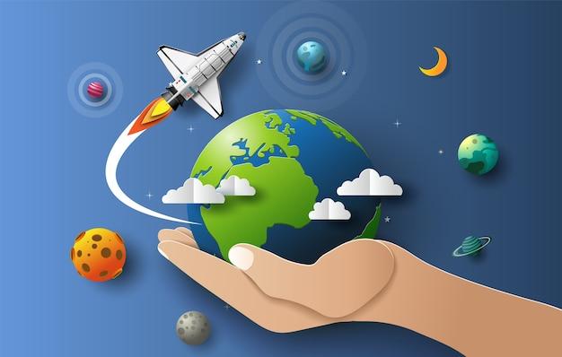 Papierkunststijl van het met de hand vasthouden van de aarde met de spaceshuttle die in de ruimte opstijgt, startconcept.