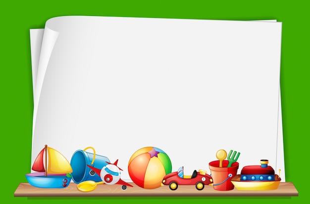 Papiersjabloon met speelgoed op de achtergrond